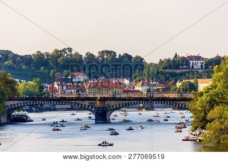 Paddleboats In The Vltava River Under Manes Bridge And Charles B