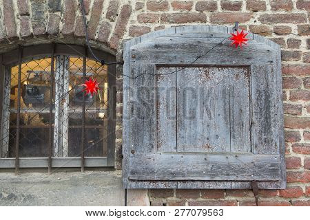 The Photo Shows A Christmas Decorated Window With Shutter