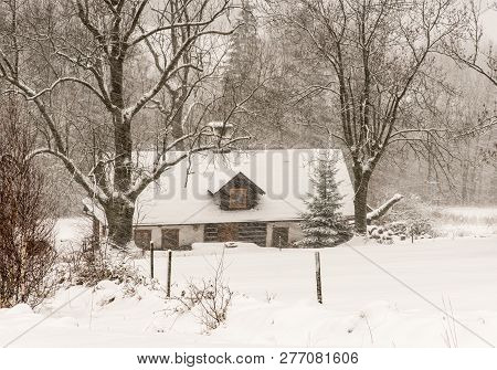 Winter Scenery With Isolated House, Trees And Snow During Heavy Snowfall Bellow Lysa Hora Hill Near