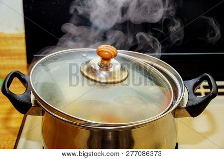 Boiling Chicken And Pork Rip Soup Or Boiled Water In Hot In Pot Boiling Food