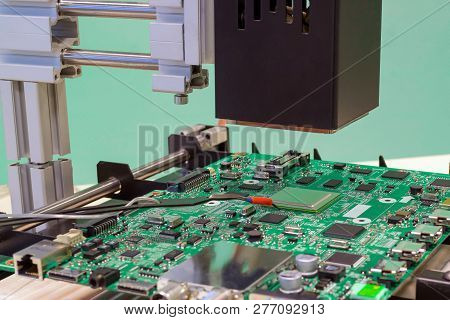 Replacing Chip In Rework Station. Infrared Soldering Station.