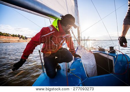 Beautiful Inspiring Shot Of Action Adventure Of Sailor Or Captain On Yacht Or Sailboat Attaching Big