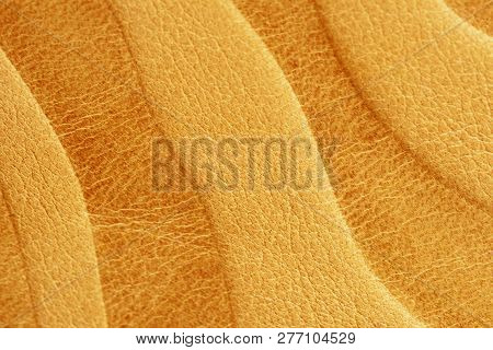Texture Of Golden Yellow Genuine Leather Close-up, With Embossed Pattern, Wallpaper Or Banner Design