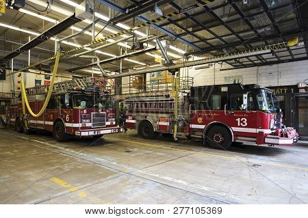 Chicago, Usa - October 9, 2018: Chicago Metropolitan Fire Trucks Sits Inside A Fire Station In Downt