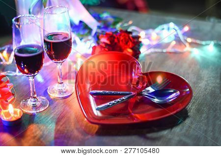 Valentines Dinner Romantic Love Concept - Romantic Table Setting Decorated With Fork Spoon On Heart