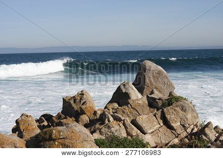 This Is Image Of Rocks And Waives Along The Coast Of Pacific Grove, California, Usa.