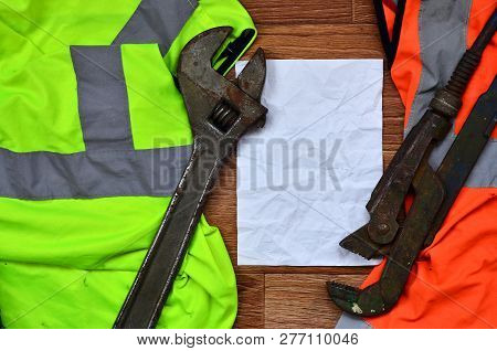 Adjustable Wrenches And Paper Lies Of An Orange And Green Signal
