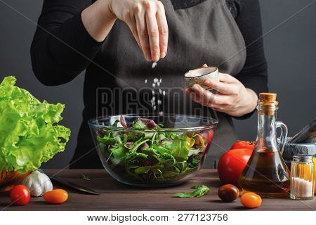 Woman Chef In The Kitchen Preparing Vegetable Salad. Healthy Eating. Diet Concept. A Healthy Way Of
