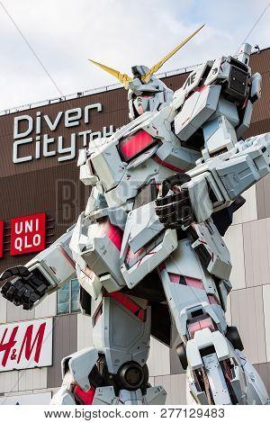 Tokyo, Japan - October 18, 2018: Full-size Mobile Suit Rx-0 Unicorn Gundam Performances At Diver Cit