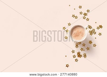 Cup Of Coffee And Golden Stars On Beige Pastel Background, Copy Space. Minimal Flat Lay With Capucci