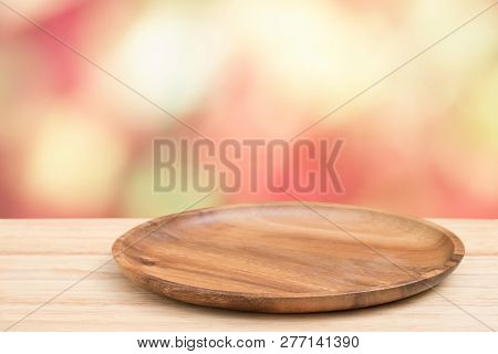 Empty Wooden Tray On Perspective Wooden Table On Top Over Blur Background. Can Be Used Mock Up For M