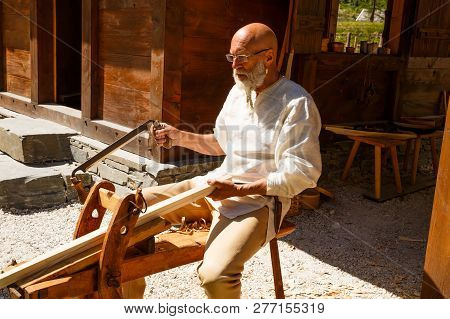 Gudvangen, Norway - June 13 - The Man Carpenter In National Clothes In The Viking Village Museum.