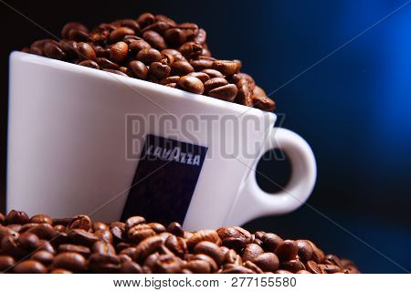 Composition With Cup Of Lavazza Coffee And Beans