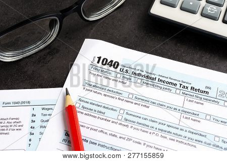 United States Federal Income Tax Return Irs 1040 Documents, With Pencil, Calculator And Eyeglasses