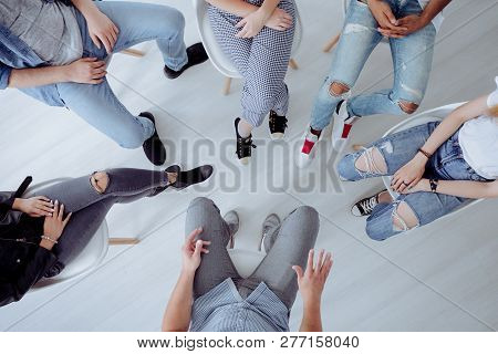 Top view of troublesome teenagers and their therapist during professional talk with counselor poster
