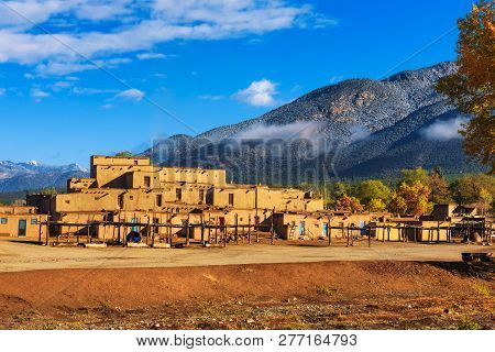 Ancient dwellings of UNESCO World Heritage Site named Taos Pueblo in New Mexico. Taos Pueblo is believed to be one of the oldest continuously inhabited settlements in USA. poster