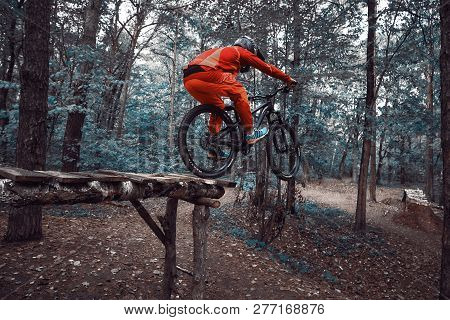 Moscow, Russia - Nov, 2018: Jump and fly on a mountain bike. Rider in action at mountain bike sport.