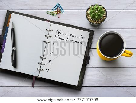 New Year Resolutions, Goals Or Action Plan Concept. Notebook On White Wooden Table With Coffee, Plan