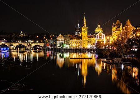Charles Bridge Over Vltava River And Old Town Waterworks Building In Prague, Czech Republic. Travel
