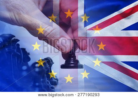 Brexit Concept With Hand Making A Chess Move And Flags Of European Union And The United Kingdom Comb