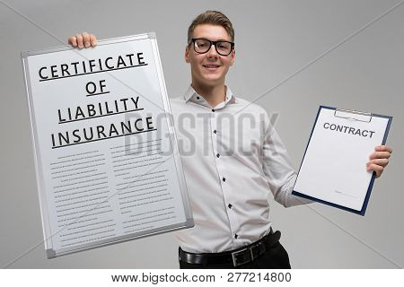 Man Holds A Poster With Inscription Certificate Of Liability Insurance And An Empty Certificate Isol