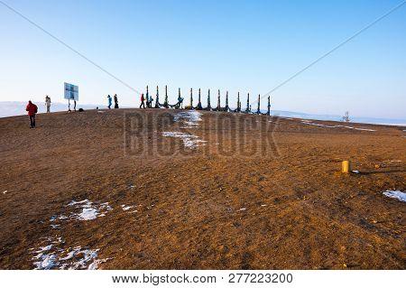 Wooden Ritual Pillars With Colorful Ribbons On Olkhon Island, Lake Baikal, Siberia, Russia