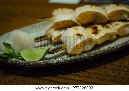 Salmon Toro Kushiyaki. Grilled Salmon Toro On Skewer In Japanese Restuarant.