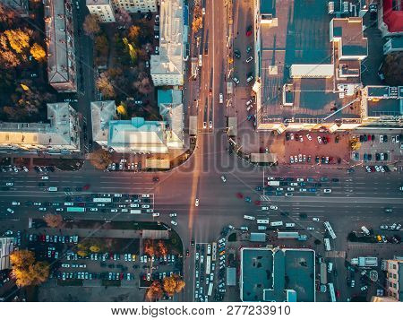 Aerial Top View Of City Asphalt Road With Lot Of Vehicles Or Car Traffic And Buildings, Modern Urban
