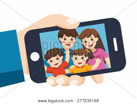Human Hand Hold Device And Selfie. Happy Family Selfie Photo On Smartphone Display. Selfie Photo Wit