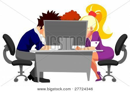 people working in office at the computer
