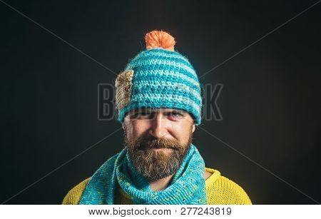 Handsome Man In Hat And Scarf. Winter Fashion. Attractive Bearded Man In Warm Knitted Hat And Scarf.