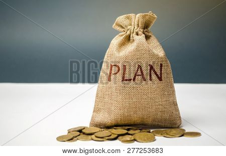 Money Bag With Coins And The Word Plan. Personal Financial Planning Concept. Management Of The Famil