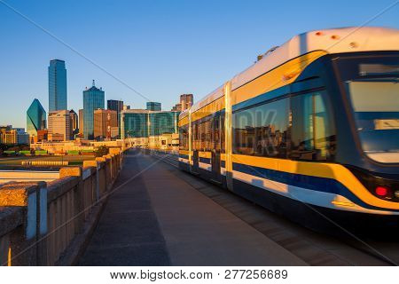 Moving Streetcar On The Houston Street Viaduct With The City Of Dallas In Background. The Dallas Str
