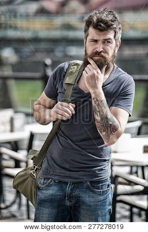 Hipster Thoughtful Traveler Carry Travel Bag. Business Trip. Man Bearded Traveler Hipster Travel Wit