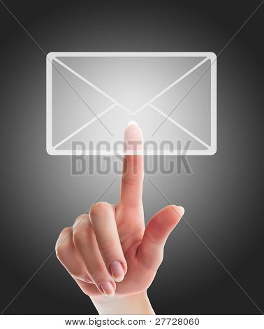Female Hand Pressing E-mail  Sign On A Touch Screen Interface Over Black And Grey Background