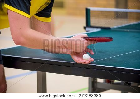 Table Tennis Player serving, close-up