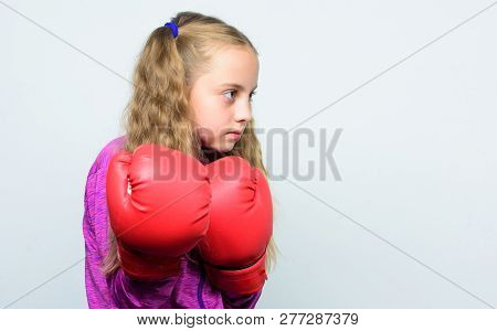 Cute Kid With Sport Boxing Gloves. Boxing Sport For Female. Sport Upbringing. Skill Of Successful Le