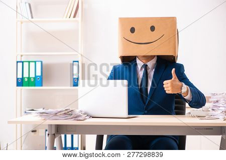 Happy man employee with box instead of his head