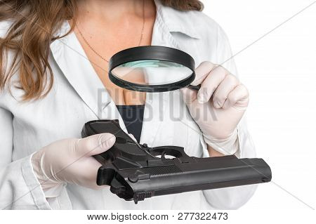 Criminology Expert Looking At Pistol And Collects Evidence