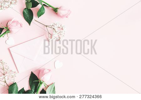 Valentine's Day Composition. Pink Rose Flowers, Envelope On Pastel Pink Background. Valentine's Day,
