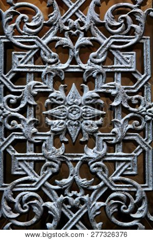 Parisian decorative metal door window in silver color with a flower in the middle