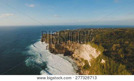 Aerial View Sea Rocky Coast With Surf The Waves, Bali, Indonesia, Pura Uluwatu Cliff. Waves Crushing