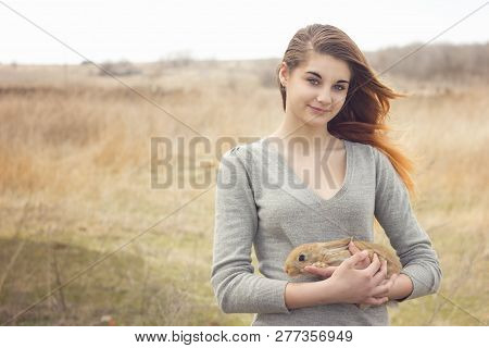 The Girl With The Rabbit.happy Little Girl Holding Cute Fluffy Bunny.friendship With Easter Bunny. S