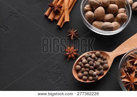 Nutmeg, Cinnamon Sticks, Badyan And Pepper On Black Bakground, Closeup