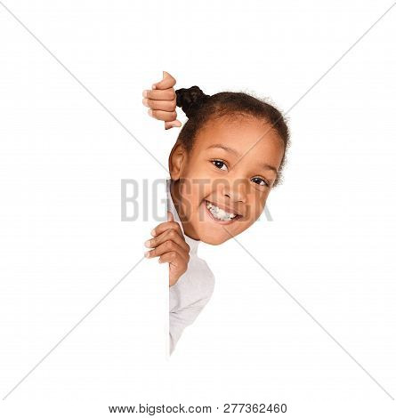 African-american Girl Peeking Out From Empty Banner Isolated On White Background
