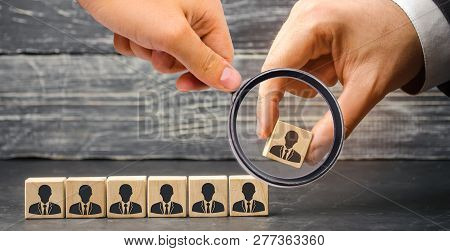The Leader Builds Team From Cubes With Employees. Businessman In Search Of New Employees And Special