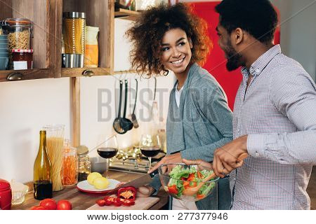 African-american Couple In Love Cooking Vegetarian Lunch Together In Kitchen, Copy Space