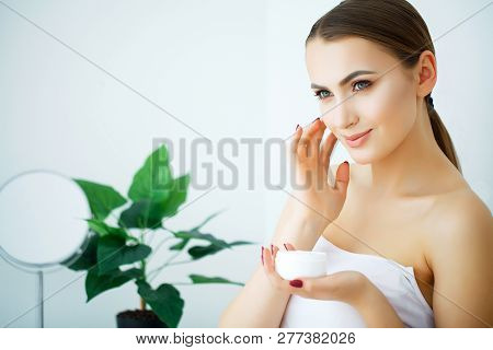 A Beautiful Woman Using A Skin Care Product, Moisturizer Or Lotion And Skincare Taking Care Of Her D