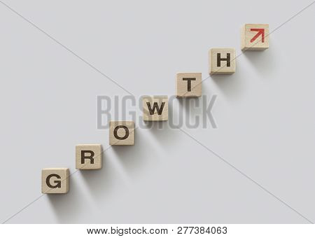 Wooden Blocks Arranged In Stair Shape With The Word Growth. Business Growth, Career Growth Or Growth