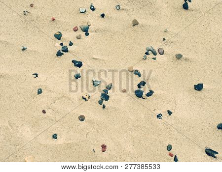 Sand Beach Of Mediterranean Sea With Colorful Rounded  Pebble In The Sand. Sunny Beach On The Sea Wi